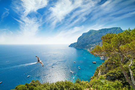 Daylight view of Marina Piccola and Monte Solaro, Capri Island, Italy. Sunny summer weather, blue sea and sky with white clouds. Banque d'images
