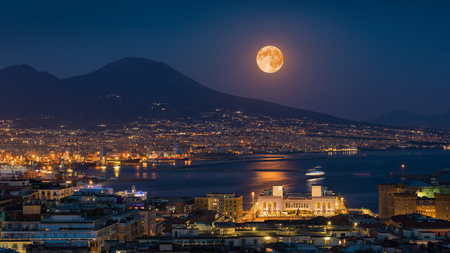 Full moon rises above Mount Vesuvius, Naples and Bay of Naples, Italy. Moonlight reflected in calm sea. Stok Fotoğraf