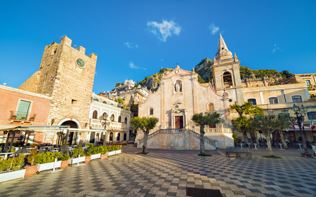 Morning view of square Piazza IX Aprile with San Giuseppe church and Clock Tower in Taormina, Sicily, Italy Stock Photo