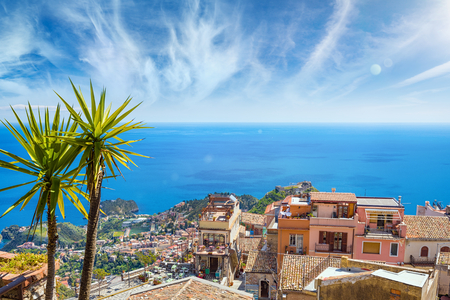 Aerial view of Castelmola and Taormina located in Metropolitan City of Messina, on east coast of Sicily, Italy Stock Photo