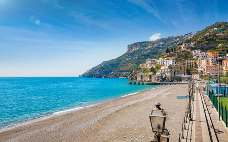 Blue sea and beach in Minori, attractive seaside town at centre of Amalfi Coast, province of Salerno, in Campania region of south-western Italy. Stock Photo
