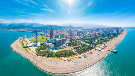 Aerial panoramic image of beautiful Batumi made with drone in sunny summer weather. Batumi is capital of Autonomous Republic of Adjara in Georgia, located on coast of Black Sea.