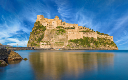 Famous landmark and tourist destination Aragonese Castle or Castello Aragonese located near Ischia Island, Italy. Stock Photo
