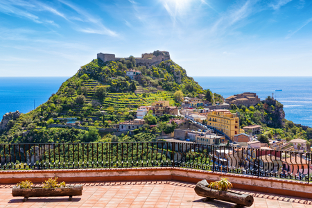 Taormina Castle, known as Castello di Taormina or Castello Saraceno, and little church of Madonna della Rocca located on green mount in Messina province on Sicily island in Italy.