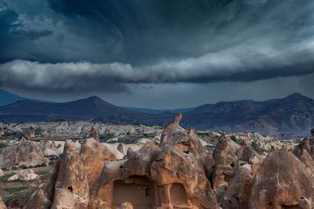 Dark stormy sky above mountain landscape, climate change and weather forecast concept