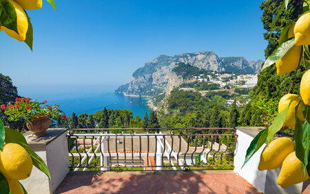 Monte Solaro on Capri Island, Italy. Beautiful paradise landscape with azure sea in summer sunny day, ripe yellow lemons in foreground. Stock Photo