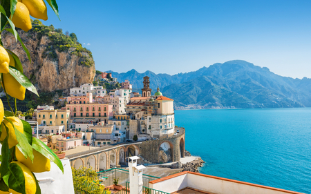 Small city Atrani on Amalfi Coast in province of Salerno, Campania region, Italy. Amalfi coast on Gulf of Salerno is popular travel and holyday destination in Italy. Ripe yellow lemons in foreground. Stock Photo