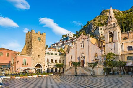 Morning view of Square Piazza IX Aprile with San Giuseppe church and Clock Tower in Taormina, Sicily, Italy. Taormina located in Metropolitan City of Messina, on east coast of island of Sicily. Reklamní fotografie