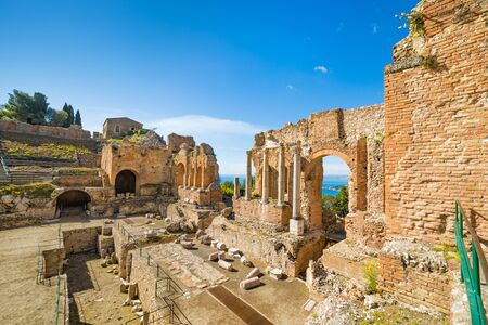 Wide angle view of ancient Greek theatre in Taormina, Italy. Taormina located in Metropolitan City of Messina, on east coast of island of Sicily.