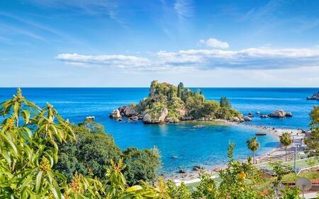 Isola Bella is small island near Taormina, Sicily, Italy. Narrow path connects island to mainland Taormina beach surrounded by azure waters of the Ionian Sea. Reklamní fotografie