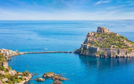 Aerial view of Aragonese Castle, most popular landmark and travel destination located in Tyrrhenian sea near Ischia island, Italy.