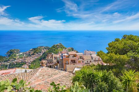Aerial view of Castelmola and Taormina located in Metropolitan City of Messina, on east coast of Sicily, Italy Reklamní fotografie