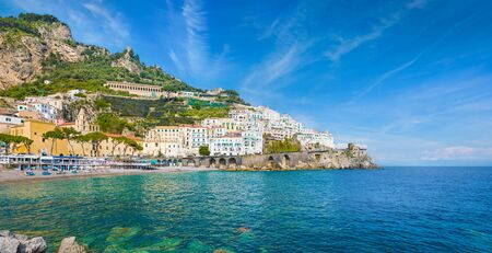 Panoramic view of beautiful Amalfi on hills leading down to coast, comfortable beaches and azure sea in Campania, Italy. Amalfi is most popular travel and holyday destination in Europe.