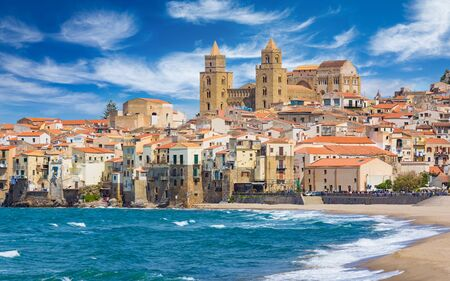 Long sandy beach and blue sea in Cefalu, town in Italian Metropolitan City of Palermo located on Tyrrhenian coast of Sicily, Italy. Cefalu is popular travel destination in Europe. Reklamní fotografie