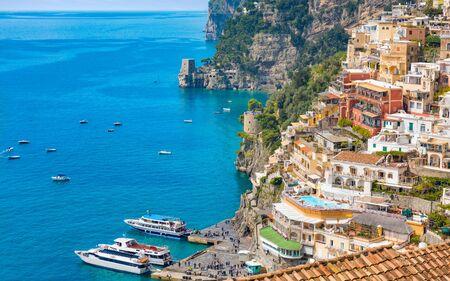 Beautiful Positano on hills leading down to coast and azure sea on Amalfi Coast in Campania, Italy.