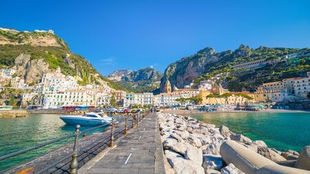 Beautiful Amalfi on hills leading down to coast, comfortable beaches and azure sea in Campania, Italy. Amalfi is most popular travel and holyday destination in Europe. Reklamní fotografie