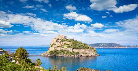 Aragonese Castle, most popular landmark and travel destination located in Tyrrhenian sea near Ischia island, Italy.
