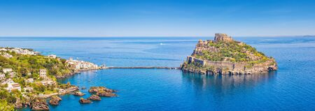 Aerial panoramic view of Aragonese Castle, most popular landmark and travel destination located in Tyrrhenian sea near Ischia island, Italy.