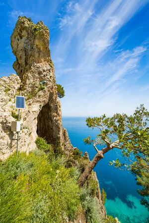 Side view of amazing natural geological formation - Arco Naturale, natural arch on coast of Capri island, Italy.