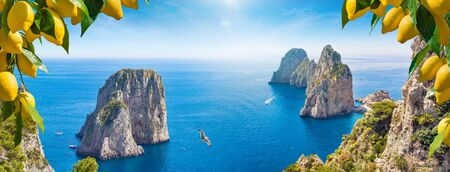 Welcome to Capri concept. Panoramic collage with different view of Faraglioni Rocks near Capri Island, Italy. Beautiful paradise landscape with azure sea in summer sunny day and ripe yellow lemons. Banco de Imagens