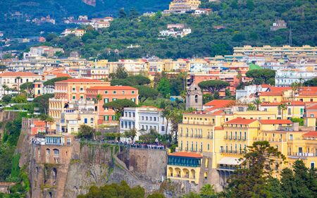 Daylight view of cliff coastline Sorrento, Italy. Comfortable hotels located on rocky shore of Gulf of Naples. Stock Photo