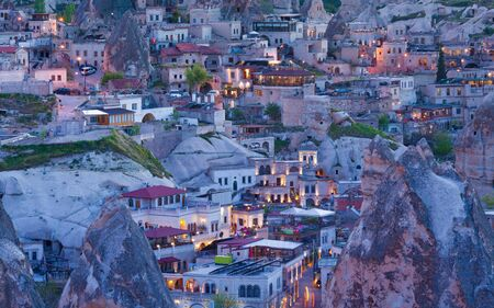Sunset view of Goreme town in Nevsehir Province, Central Anatolia located among amazing rock formations in Cappadocia region of Turkey.