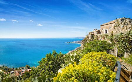 Church of Madonna della Rocca built on rock in Taormina, blue Gulf and beach of Giardini-Naxos, Sicily, Italy. 写真素材