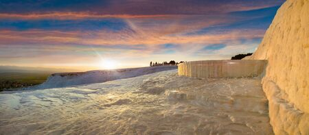 Sunset panoramic view of Pamukkale. Travertine terrace formations left by flowing thermal springs in Pamukkale, literally 写真素材