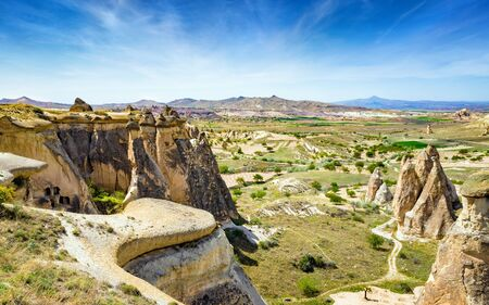 Amazing rocks in Cappadocia near Goreme eroded into spectacular pillars and minaret-like forms. Cappadocia is very popular tourist destination in Turkey. Banco de Imagens