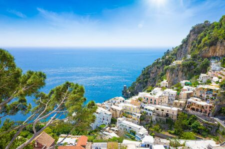 Aerial view of beautiful Positano and clear blue sea on Amalfi Coast in Campania, Italy. Amalfi coast is popular travel and holyday destination in Europe. Banco de Imagens