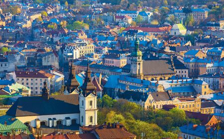 Aerial sunset view of historical old city district with churches, cathedrals and houses roofs in Lviv, Ukraine. Lviv is one of main cultural centres and largest city and in western Ukraine.