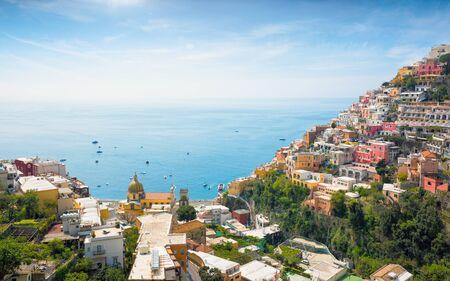 Aerial view of Positano on hills leading down to coast and azure sea on Amalfi Coast in Campania, Italy. Positano is picturesque town with splendid coastal views on famous Amalfi Coast. Reklamní fotografie