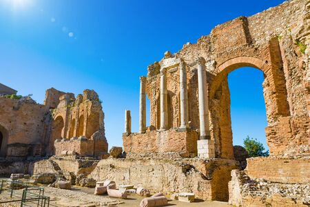 Ruins of ancient Greek theatre of Taormina against clear blue sky in sunny weather, Sicily, Italy. Foto de archivo