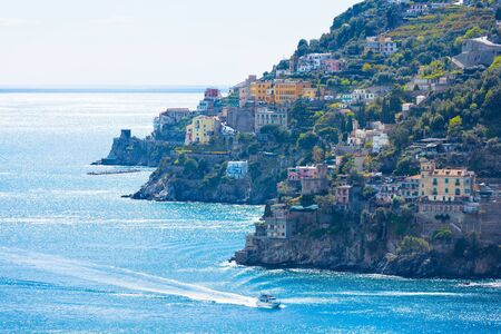 Part of Amalfi Coast with coloured terrace houses on hills leading down to azure sea located between Amalfi and Atrani in southwestern region of Campania, Italy. 免版税图像