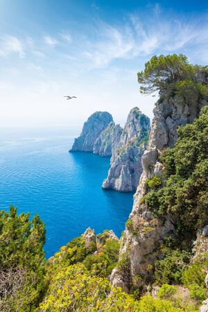 Famous Faraglioni Rocks near Capri, Italy. Beautiful paradise image with azure sea in summer sunny day. Island of Capri is situated 5 km from mainland in Bay of Naples.