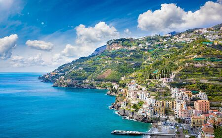 Blue sea and marina in Minori, attractive seaside town at centre of Amalfi Coast, province of Salerno, in Campania region of south-western Italy.