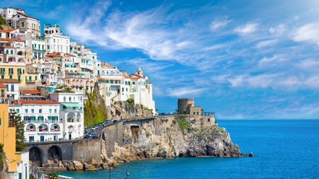 Beautiful Amalfi on hills leading down to coast, Campania, Italy. Amalfi coast is most popular travel and holiday destination in Europe. 免版税图像