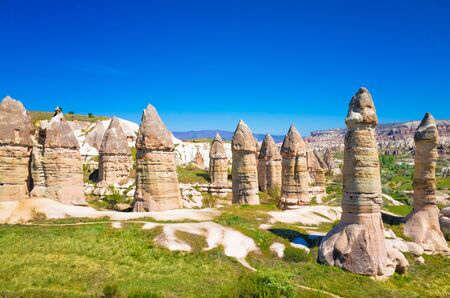 Amazing rocks in Cappadocia near Goreme eroded into spectacular pillars and minaret-like forms. Cappadocia is very popular tourist destination in Turkey. 免版税图像