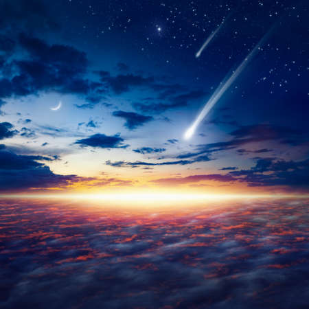 Amazing heavenly image with beautiful glowing sunset, shooting stars, rising crescent moon and bright stars.