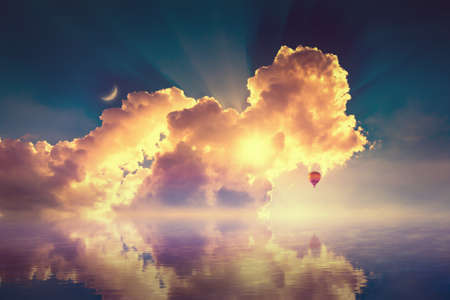 Amazing heavenly image — crescent, pink clouds and hot air balloon rising above serene sea, light from heaven. Elements of this image furnished by NASA.