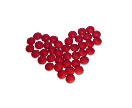 administer: red tablets heart isolated on white Stock Photo