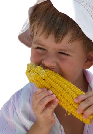 boy with corn isoladted on white background with clipping path Stock Photo