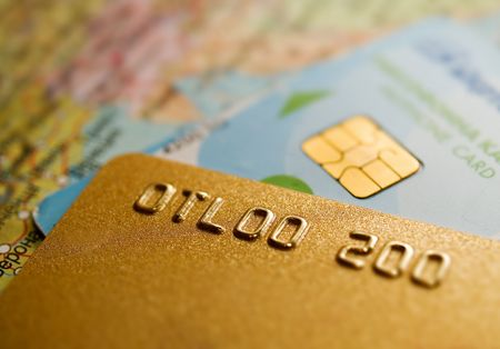 credit card closeup with geographic map background Stock Photo