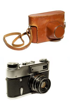 old-fashioned photocamera and leather case isolated on white. used look. Stock Photo