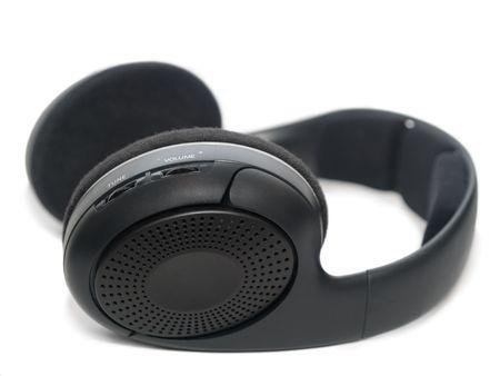 closeup of wireless headphones isolated on white. shallow dof. focus is on the tune wheel Stock Photo