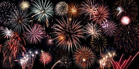 many bright coloured fireworks over black background