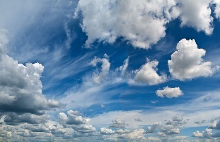 blue summer sky with bright clouds. horizontal