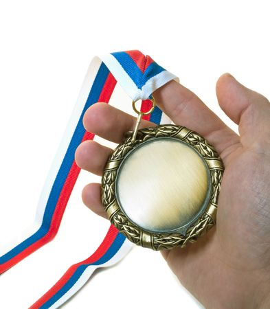 medal in hand isolated over white Stock Photo
