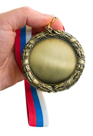 gold medal in hand isolated over white