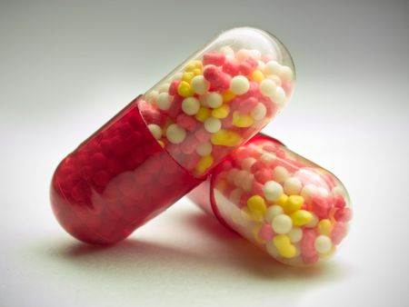 medical capsules isolated over white. shallow dof Stock Photo